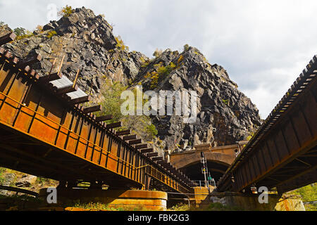 Harpers Ferry train tunnel and bridge across Shenandoah River in West Virginia, USA. - Stock Photo