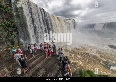 Tourists snapping the falls from the viewing platform,  Foz do Iguacu, Brazil side - Stock Photo