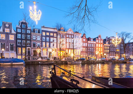 The Ambassade Hotel on the Amsterdam Herengracht Canal in winter with seasonal Christmas lights. - Stock Photo