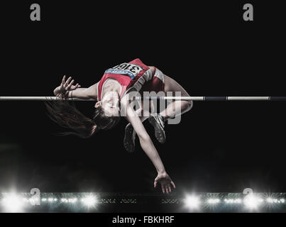 High jump female athlete Stock Photo