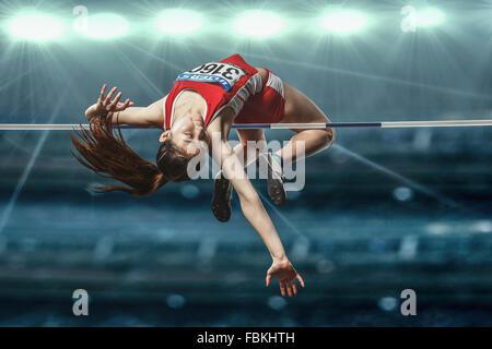 Japanese female high jump athlete jumping Stock Photo