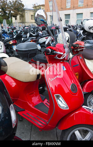 Vespa scooter parked in a motorbike parking area in Siena, Tuscany, Italy - Stock Photo