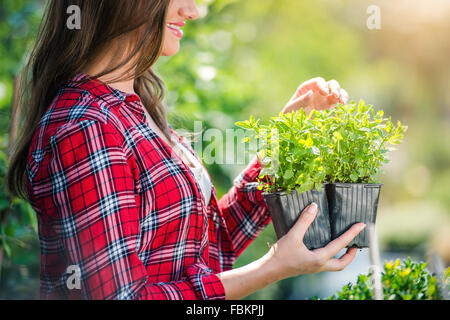 Beautiful young woman gardening - Stock Photo
