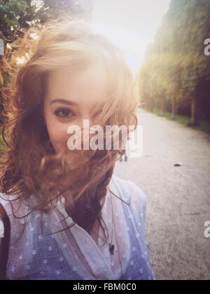 Portrait Of Beautiful Young Woman On Street - Stock Photo