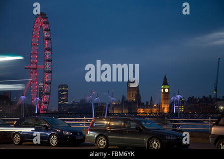 Big Ben Houses of Parliament and London Eye view from Waterloo Bridge at night - Stock Photo