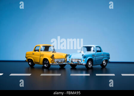 Two Classic fifties scale model toy cars from front view. - Stock Photo