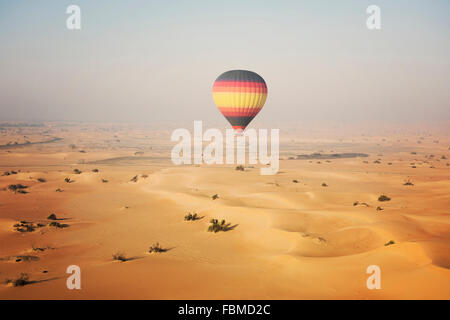 Hot air balloon over the desert, Dubai, United Arab Emirates - Stock Photo