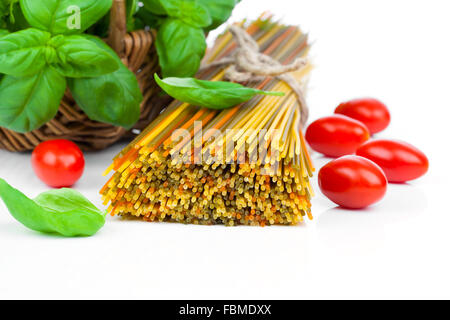 Fresh pasta and italian ingredients, isolated on white background - Stock Photo