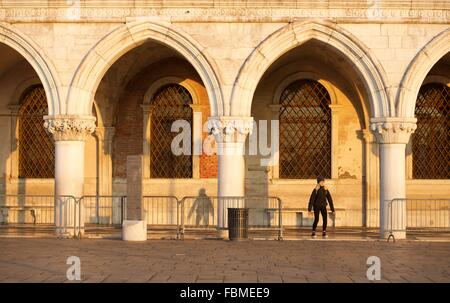 Woman practicing yoga in San Marco square, Venice, Italy - Stock Photo