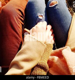 Close-up of a Couple holding hands - Stock Photo