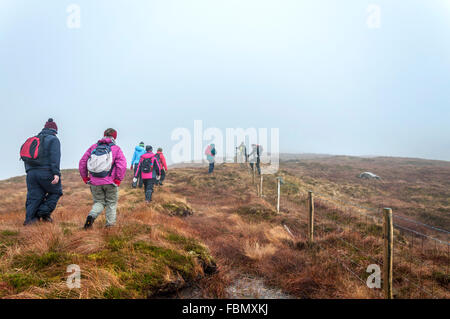 Walkers in mist on Common Mountain above Ardara, County Donegal, Ireland - Stock Photo