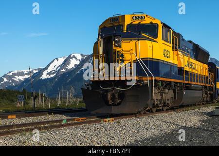 An Alaska Railroad train traveling between Seward and Anchorage by Turnagain Arm, Southcentral Alaska, United States - Stock Photo