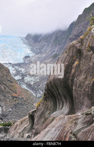 Carved patterns in the Vertical schist rock walls in the Franz Josef Glacier as it receeds  due to melting ice - Stock Photo