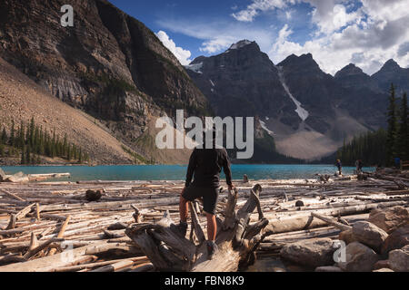A man enjoying the view of Moraine Lake, Banff National Park, Alberta, Canada, America (Canadian Rocky Mountains). - Stock Photo