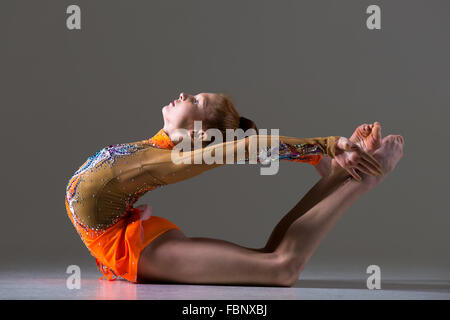 Beautiful gymnast athlete teenage girl wearing dancer colorful leotard working out, dancing, posing, doing backbend, - Stock Photo