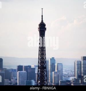High Section Of Eiffel Tower Against Buildings In City - Stock Photo