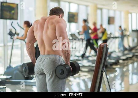 Bodybuilder's strong back. - Stock Photo
