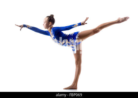 Beautiful ballerina teenage girl wearing dancer blue leotard working out, dancing, posing, doing balance art gymnastics - Stock Photo