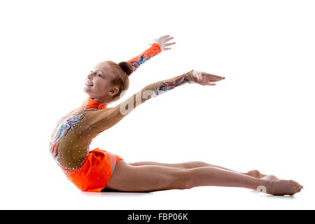 Attractive happy gymnast athlete teenage girl wearing dancer colorful leotard working out, dancing, posing, doing - Stock Photo