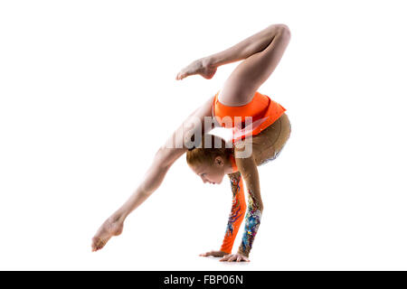 Beautiful gymnast athlete teenage girl wearing dancer colorful leotard working out, dancing, doing backbend, handstand - Stock Photo