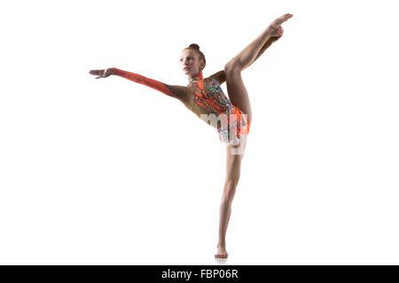 Beautiful gymnast athlete teenage girl wearing dancer colorful leotard working out, dancing, posing, doing balance - Stock Photo