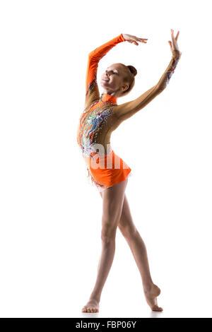 Beautiful happy teenage fit ballerina girl wearing dancer colorful leotard working out, dancing, posing, doing rhythmic - Stock Photo