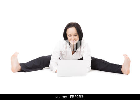 Business, study, healthy lifestyle. Smiling young female office employee in formalwear doing splits, working in - Stock Photo