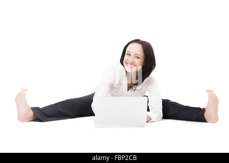 Happy, healthy work and study. Smiling young female office employee in formalwear doing splits, sitting in yoga - Stock Photo