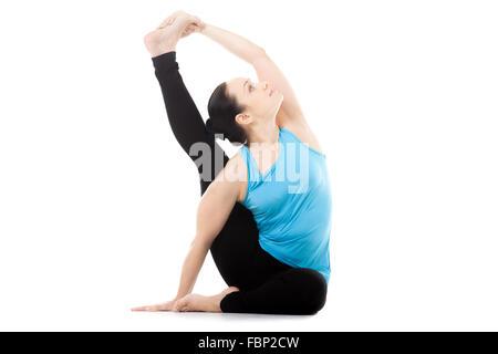 sporty yogi girl doing fitness exercises backbend asana