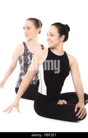 woman doing yoga asana parivrtta janu sirshasana stock