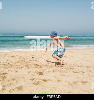 Boy Playing At Beach - Stock Photo