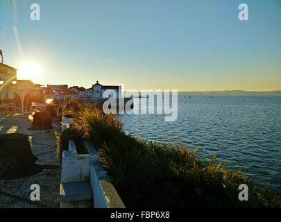 Houses By Lake Against Clear Sky - Stock Photo