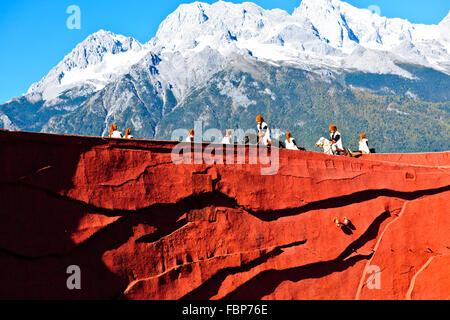Jade Dragon Snow Mountain,Ethnicity show designed by Mr Li Jing Yenxung,who mastered Beijing Olympics,Lijiang,Yunnan,PRC,China - Stock Photo