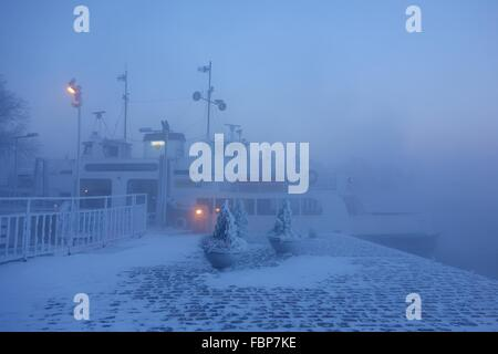 Ferry in Suomenlinna fortress island on extremely cold winter morning - Stock Photo