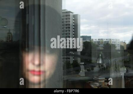 Reflection Of Young Woman On Glass Window - Stock Photo