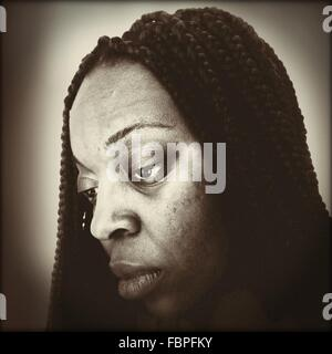 Portrait Of Woman Looking Down - Stock Photo