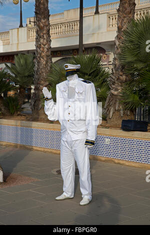 Living statue street entertainer dressed up as a ships captain in Cartagena Spain - Stock Photo