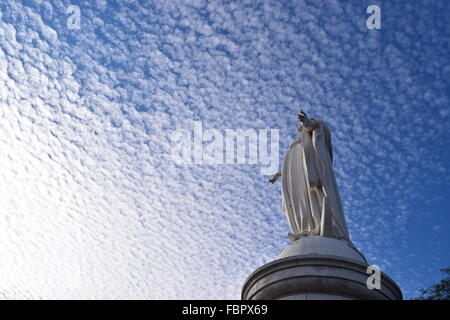 Statue of the Virgin Mary  and clouds on the top of Cerro San Cristobal, Santiago - Stock Photo