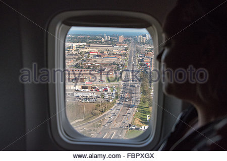 Window view from tourist plane when arriving to Toronto city. Tourists returning from Cuba tor Pearson International - Stock Photo