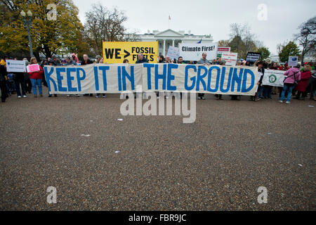November 21, 2015, Washington, DC USA: Environmental activists protest in front of the White House (protesters holding - Stock Photo