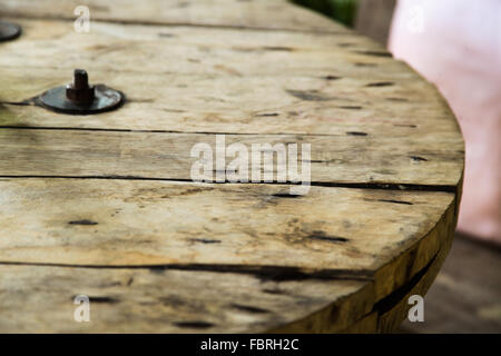 Chiang Mai, Thailand, 2016. Reused wooden cable roll used as a table in restaurant - Stock Photo