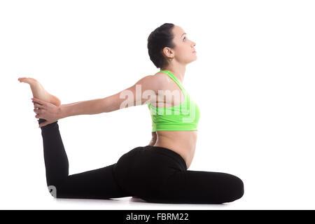 beautiful yoga one legged king pigeon pose stock photo