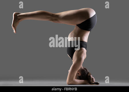 sporty teenage yogi girl exercises yoga asana doing ardha
