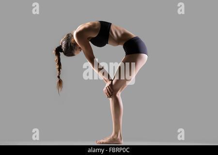 sporty teenage yogi girl exercises doing yoga asana