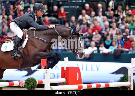 Leipzig, Germany. 17th Jan, 2016. Sweden's Rolf-Goran Bengtsson riding Casall ASK jumps over a hurdle during the - Stock Photo