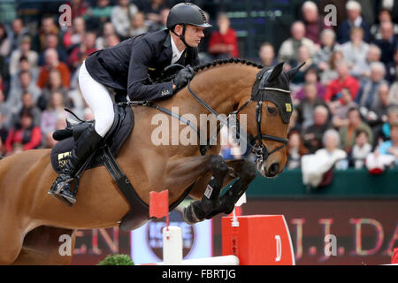 Leipzig, Germany. 17th Jan, 2016. Germany's Marco Kutscher riding Chaccorina jumps over a hurdle during the show - Stock Photo