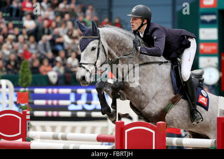 Leipzig, Germany. 17th Jan, 2016. Germany's Alexander Hinz riding Campitello jumps over a hurdle during the show - Stock Photo