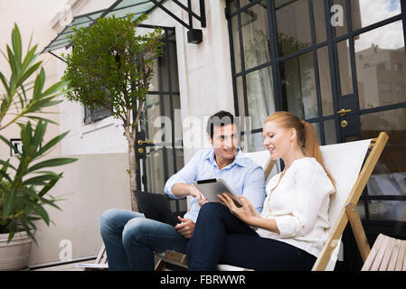 Colleagues meeting informally during business trip - Stock Photo