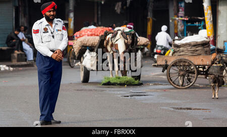 A Punjabi policeman ruling traffic in Amritsar, India. - Stock Photo