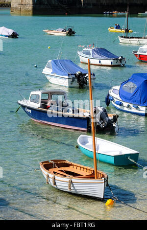Small fishing boats and pleasure craft in St Ives Harbor - Stock Photo